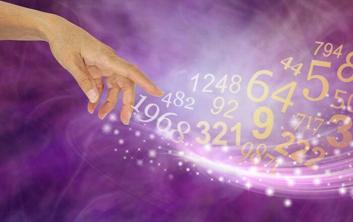 Female hand appearing to create a swish of sparkles and a flow of random numbers on a pink purple energy formation background