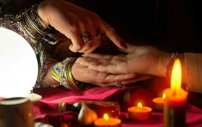 Gypsy woman reading future from another woman's palm